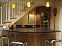 Home Bar Under Stairs- great way to add more space with the curved counter