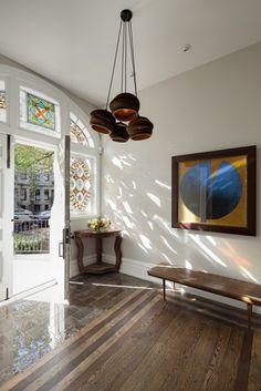 beautiful original hardwood flooring — a white oak with an ebony and walnut stain, slate tile