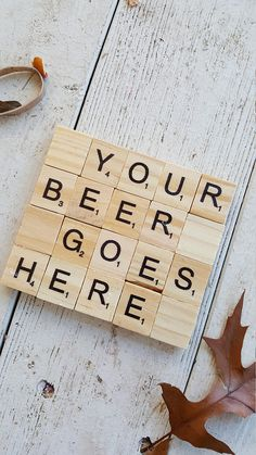 Coasters made with Scrabble tile with saying Your beer goes here. Tiles glued to cork and sprayed with polyurethane so they can be wiped off! Perfect as a creative and inexpensive gift for any occasion! Light weight yet durable, put together with E6000 glue. 3x3 1/2 inches. Set of