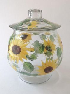 Cheerful shades of yellows and golds, rich browns and beautiful greens hand-painted encircling a one gallon cookie jar and separate lid. 10 inches tall by 9 in