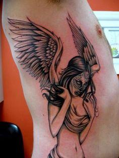 Santa muerte angel tattoo on ribs
