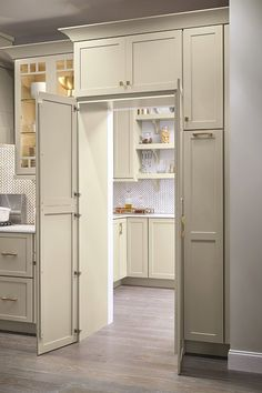 Is a walk-in pantry at the top of your kitchen remodel wish list? The Pantry Walk-Through Cabinet allows you to maintain design cohesion with full-height cabinet doors that serve as a doorway to a second space. #kithen #kitchenpantryideas