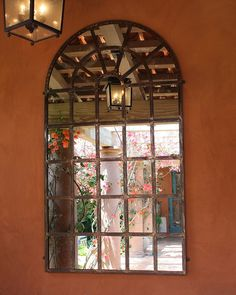 At first glance, this mirror in the courtyard garden looks like the beautiful arched windows that are commo...