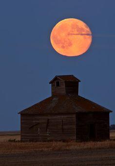 Full moon over old Saskatchewan Barn