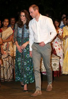 Catherine, Duchess of Cambridge and Prince William, Duke of Cambridge watch dancing by the fireside during a Bihu Festival Celebrationat Diphlu River Lodge on day 3 of the royal visit to India and Bhutan on April 12, 2016 in Kaziranga, India.