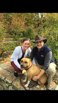 Sweet Dee, a 6-year-old pit bull, sits with her owners, West Roxbury residents Elliott Nerland and his wife, Erin Daly, who adopted her from the MSPCA's Boston adoption center. The dog was credited with recently helping to save Nerland's life. Courtesy photo