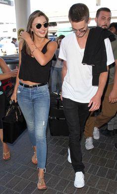 Miranda Kerr and billionaire beau Evan Spiegel arrive at LAX on Wednesday.