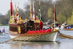 Queen's Row Barge, Gloriana: a 94-foot red and gold-gilt replica of a Tudor-era royal barge powered by 18 oarsmen in scarlet tunics. built for the Queen's Diamond Jubilee