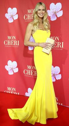 #Elle_McPherson in a #strapless #yellow floor-length gown