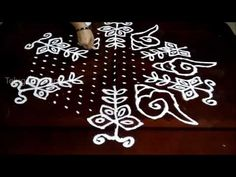 Sankranthi Flowers kolam designs with17-9 middle | chukkala muggulu with...