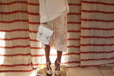 Slouchy sweater with a subtlly feminine skirt. Gorgeous look.