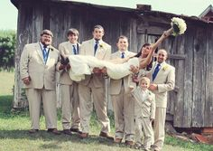 Favorite wedding photos - Valerie Shelton Photography ... bride with groomsmen .... little brother ringbearer not too happy with the guys roughing up his big sister ♥