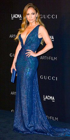 Curve-enhancing silhouette. Super-low neckline. Lots of sparkle. This Gucci gown has everything Jennifer Lopez loves, and she's probably the only person on the planet who would could pull it off.