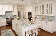 Nice white kitchen with White Milk Glass Subway Tile back splash - love the rug as well!