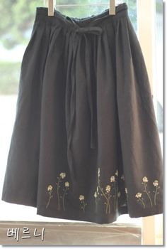 Chocolate brown skirt with embroidered hem