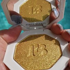 """ᴛʜᴇ ᴍᴀᴋᴇᴜᴘ ᴍɪɴx shared a post on Instagram: """"So stunning!! @fentybeauty #trophywife 3D hyper-metallic gold highlighter! Featured in the March…"""" • Follow their account to see 218 posts. Trophy Wife, Makeup Obsession, Metallic Gold, Birthday Candles, March, Posts, 3d, Instagram, Messages"""