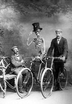 skeleton and victorian man riding bikes