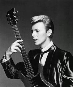 Him and that dern guitar, again.