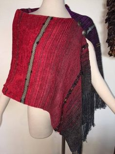 This handwoven ponchito is made of luxurious, soft chenille and bamboo yarns in rich sunset colors of scarlett and purple, accented at the shoulder with 2 silver-tone and turquoise buttons. The buttons are for decor and do not have buttonholes. You can wear this piece with the