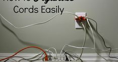 How to Organize Cords Easily Cord Hider, Tv Cords, Behind Couch, It Field, Cord Organization, 21st Century, Clothes Hanger, Husband, Bed