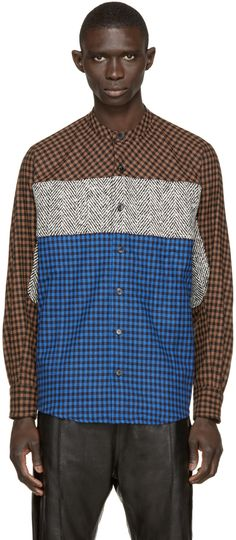 Long sleeve shirt in black, blue, and brown. Alternating herringbone and gingham check pattern throughout. Band collar. Button closure at front. Tonal stitching. Single-button barrel cuffs.
