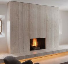 Travertine fireplace, architect John Pawson