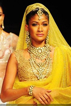 A model walks the ramp at India International Jewellery Week