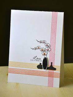 I like this card. very classic and pretty. I could make a similar card with my cherry blossom stamp and my ctmh vases. for the lines use one of the asian border stamps!