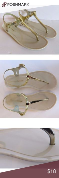 Tommy Bahama Gold Tstrap Jelly Sandals Buckel Sz 8 Tommy Bahama Women's Gold T-strap Jelly Sandals Beach Flip Flops Buckle Size 8  This listing is for a pair of women's Tommy Bahama gold t-strap sandals/flip flops in size 8. These sandals would be great for everyday wear or for the beach/pool! These are in excellent pre-owned condition. There are 2 very small discolorations on the foot bed on the left sandal. These spots are hardly noticeable. I included photos, but the spots look like tiny…