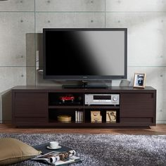 Add style and flair to your home with this Irvine Contemporary Entertainment TV Console The open shelves provide plenty of space to store your CDs, DVDs, books, and other items. There are also two add
