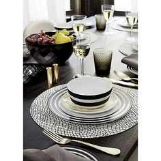 "<span class=""copyHeader"">chic circles.</span> Graphic black bands circle clean white porcelain in this modern…"