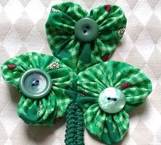 On Penny's blog there is a tutorial/pattern  for a heart shaped yo-yo pattern.  If you make three hearts out  of green fabric, you can make...