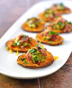 Baked sweet potato chips topped with avocado,bacon, and fresh cilantro. This easy appetizer is the winner at any party. Easy to make and impossible to resist!