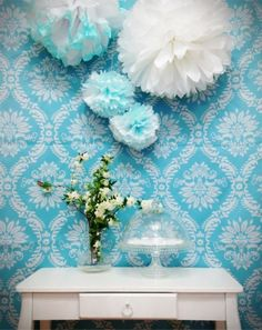 We could add a couple fun pom poms in blue. I've seen this done at other showers and it's cute, plus we could put them outside the house so guests know they have the right place!
