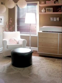 gorgeous baby girls room! But i would change the color of that black ottoman