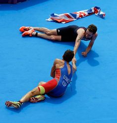 Great Britain's Alistair Brownlee is congratulated by Spain's Javier Gomez after Brownlee won the gold medal in the men's triathlon