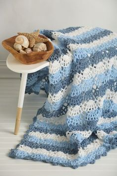 Bring the coast to you by crocheting this lacy and airy design. It's the perfect afghan for the summer months to bring some cool into the home.