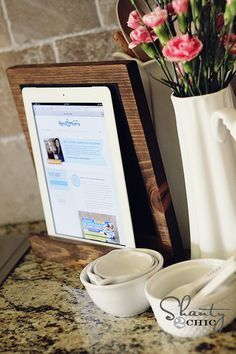 DIY iPad Stand - Shanty2Chic - How ingenious is this??  I don't have an iPad, but it would work great for my Nook Tablet when I'm using it for recipes.  I've always hated laying it on the counter incase something gets spilled on it.