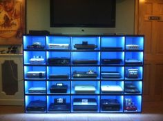 Console display cabinet - not sure about the lighting though - very distracting! Like how neat it looks, definitely need to have cables hidden.