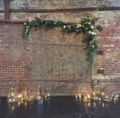 A garland of silver dollar eucalyptus, dripping green amaranthus, and Italian ruscus with scattered white hydrangeas, ivory spray roses, and pops of coral peonies and Juliet garden roses will be draped over the altar metal art piece.