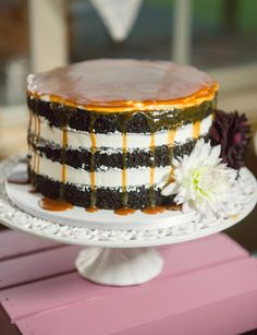 Naturally, the stacked layers of cake and frosting create beautiful horizontal lines, but we love the look of contrasting drips of caramel or chocolate gnash for some subtle flare—and a touch more flavor! l TheKnot.com