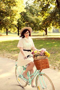 Mint beach cruiser, red lips, dark horn-rimmed glasses & lob, pale fedora, cream lace summer dress, caramel basket w/ pink & yellow flowers