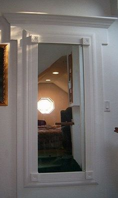 hidden door with mirror, my next house will totally have a hidden panic room!