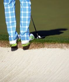April 9: Rickie Fowler took a precarious stance as he worked on his short game. Love the golf pants!