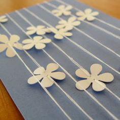 this is actually a paper garland but i like the idea of stringing it on paper and making a card