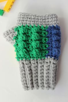 These fingerless gloves will be the perfect way to keep your kiddos hands warm while building! Lego inspired fingerless gloves should fit most children. Crochet Hand Warmers, Crochet Gloves, Hand Crochet, Free Crochet, Mitten Gloves, Mittens, Crochet Lego, Crochet Squares, Cross Stitch Embroidery