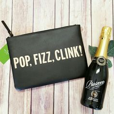 """1 Hr Sale! Kate Spade Pop, Fizz, Clink! Gia The perfect party piece! Absolutely adorable (and gorgeous!), NWT Kate Spade """"Pop, Fizz, Clink!"""" Crystal Court Gia large clutch in soft black leather with rose gold- foil lettering, 14K gold- plated hardware, bright red jacquard lining and zippered top closure. Approx. 10"""" in length, 7"""" in height and. 5"""" wide. kate spade Bags Clutches & Wristlets"""