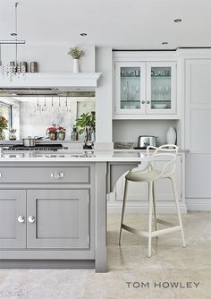 The L shaped kitchen has a main run of cabinets along the back wall with an abundance of practical storage and integrated appliances on the other. Floor-to-ceiling cabinets utilise every inch of space, making the kitchen feel grand. With busy lives it's often hard to control everyday clutter, keeping all belongings well organised.