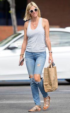 """RHONY"" star Kristen Taekman accessorized a chill tank and torn jeans with retro round sunnies in bright white!"