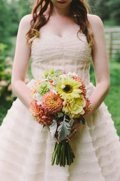 citrus-hued bouquet, photo by Brett & Jessica http://ruffledblog.com/lady-luck-farms-asheville-wedding #flowers #yellow #orange